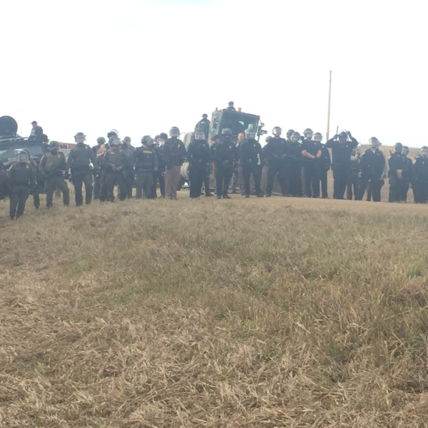Law Enforcement Line up in front of Protestors on Road 134