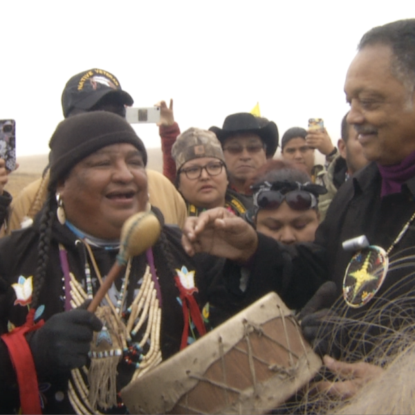 Reverend Jesse Jackson speaks with activists at the Oceti Sakowin camp near Cannonball