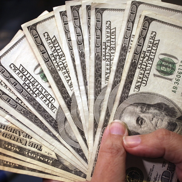 Hand full of cash $100 bills-159532.jpg87556334