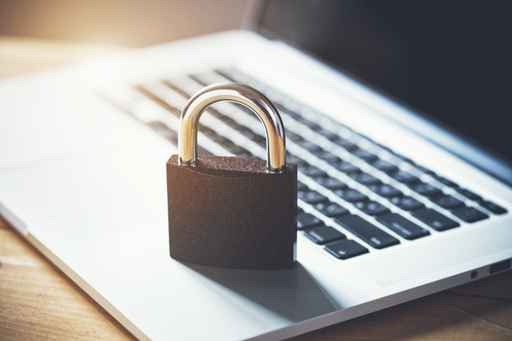 Lock on laptop as computer protection and cyber safety concept. _1553113269534