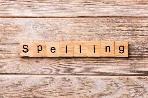 spelling word written on wood block. spelling text on wooden tab_1553090210562