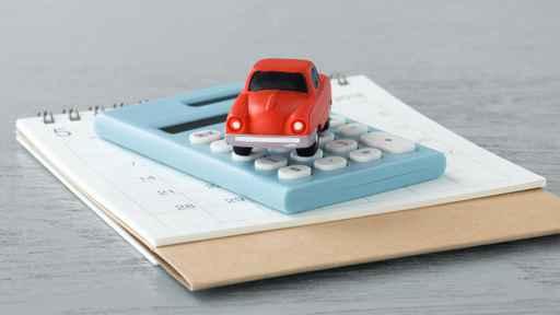 Toy car on caculator and calendar_1558109178862