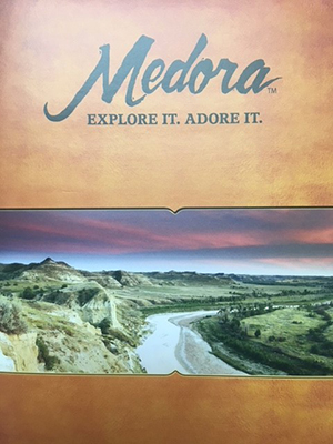 This image has an empty alt attribute; its file name is Medora-Picture-Small.jpg